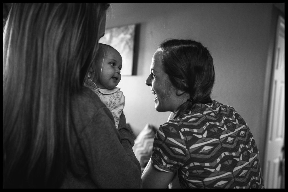 Woman smiles at baby girl, black and white, Aurora, Colorado