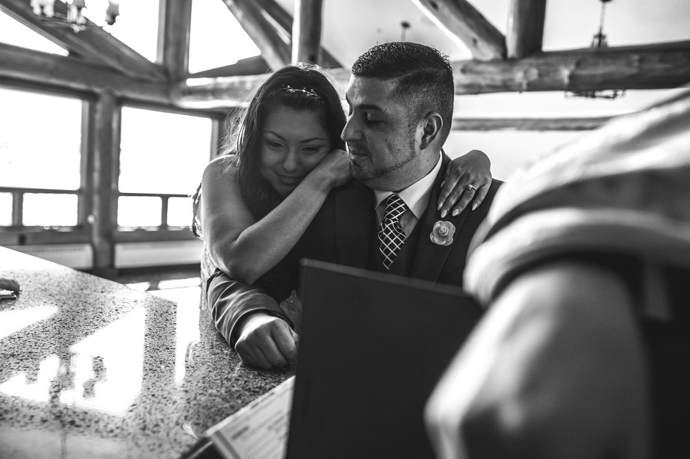 Bride leans on her new husband and smiles, Estes Park, Colorado, black and white