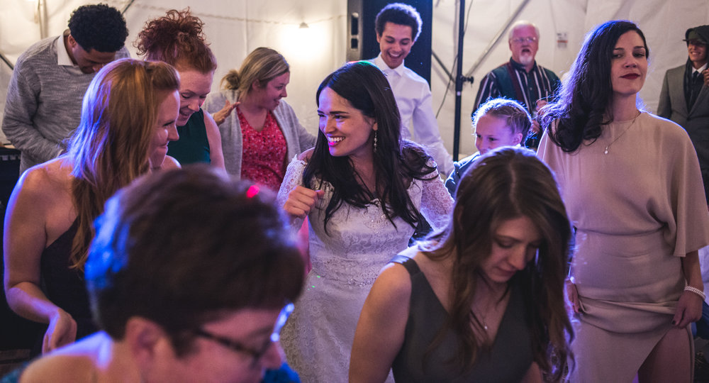 Bride dances with all of her guests on the dance floor at her wedding reception