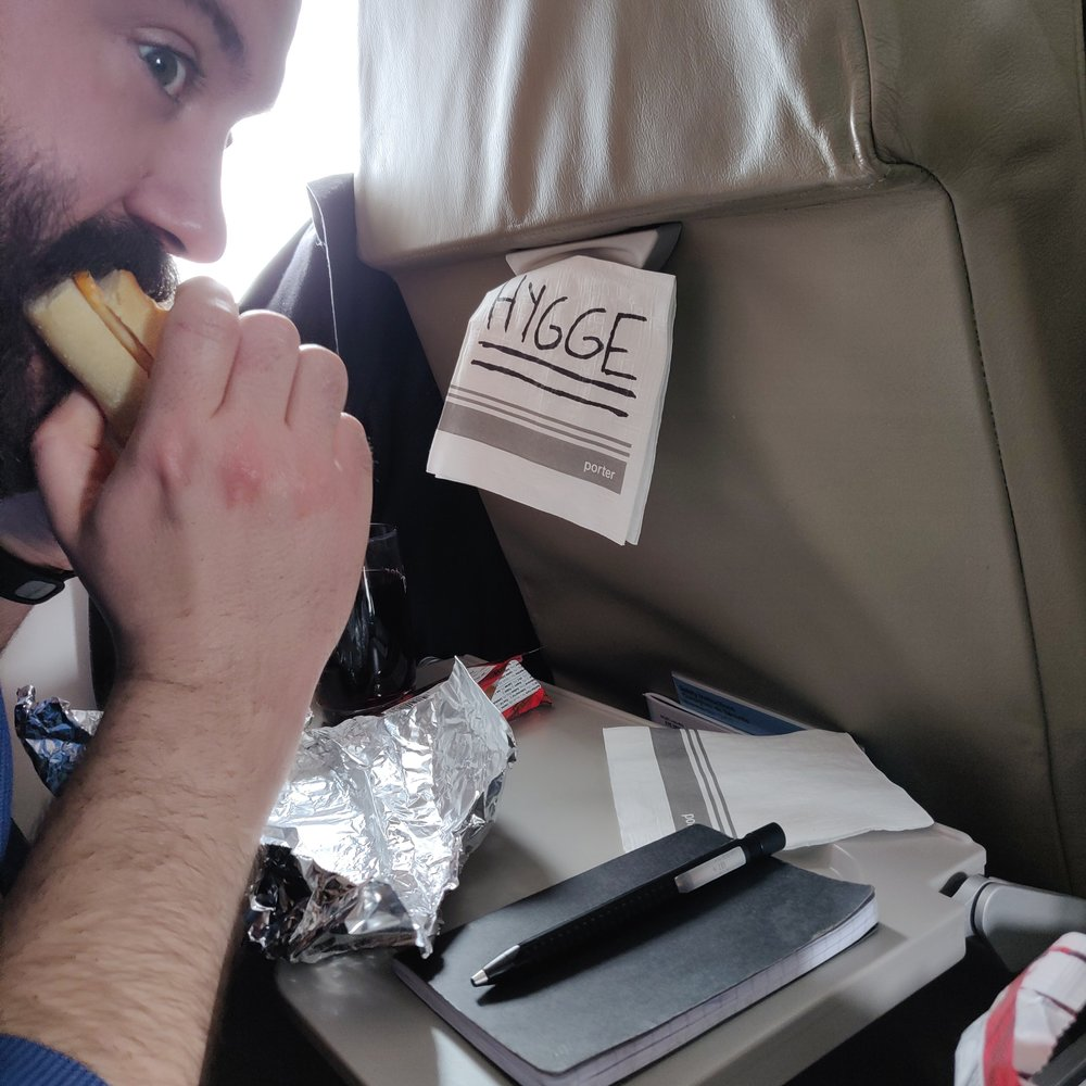 Homemade sandwiches on a plane with a glass of red, and shortbread cookies? This is hygge.
