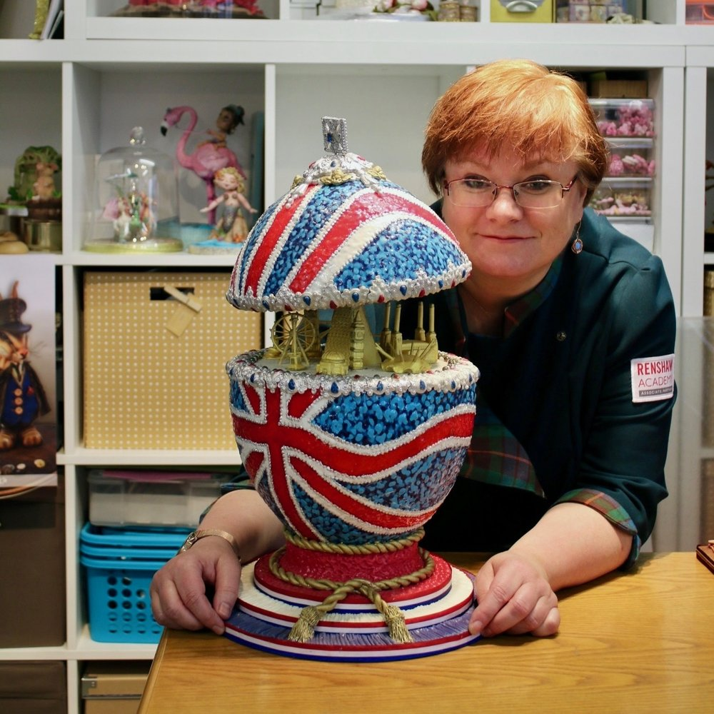 Jacqui Kelly Studio 24 A multi-award winning cake artist and sugar sculptor, with commissions from Harrods to HRH Queen Elizabeth II to corporate buyers and the couple next door. 14-time Gold Medal winner at Cake International with installations and teaching from London to Miami.