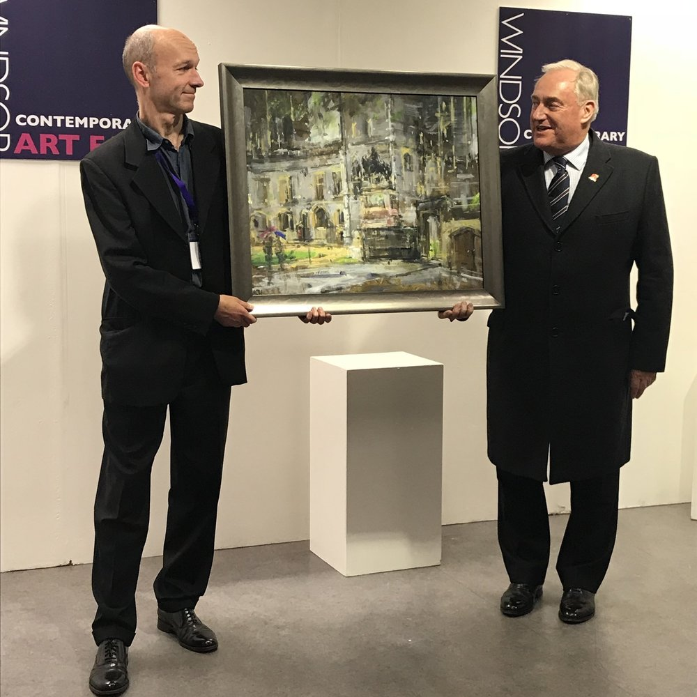 Andrew Horrod handing over his winning painting from Windsor and Eton en plein air 2017