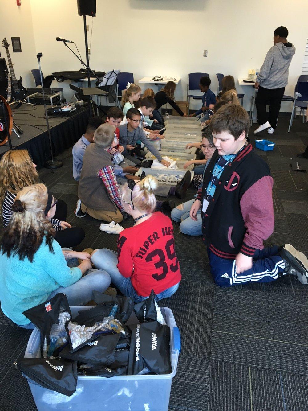 Deloitte_Kids Packing Donations for Glencliff.JPG