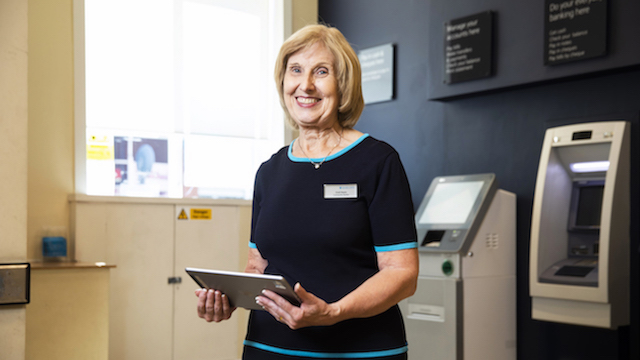 For Barclays. Pictured is Enid Hayes at the Barclays Bank branch in Longton, Stoke-on-Trent. Enid has worked for Barclays for over 50 years. Photo by Fabio De Paola