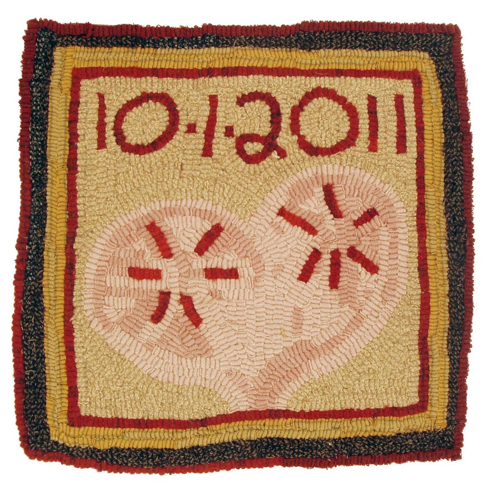 Hooked rug with heart and wedding date
