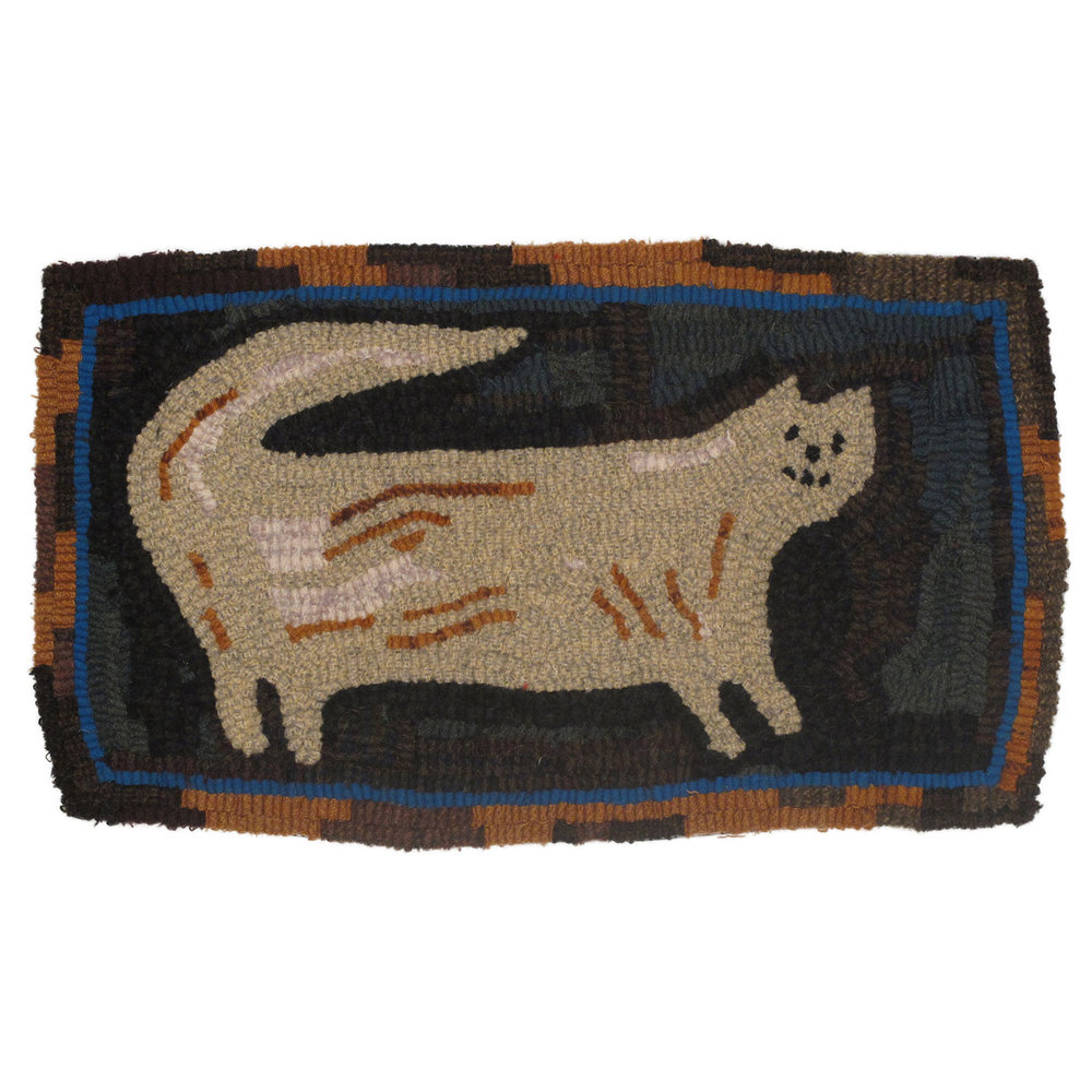Hooked rug of tan cat