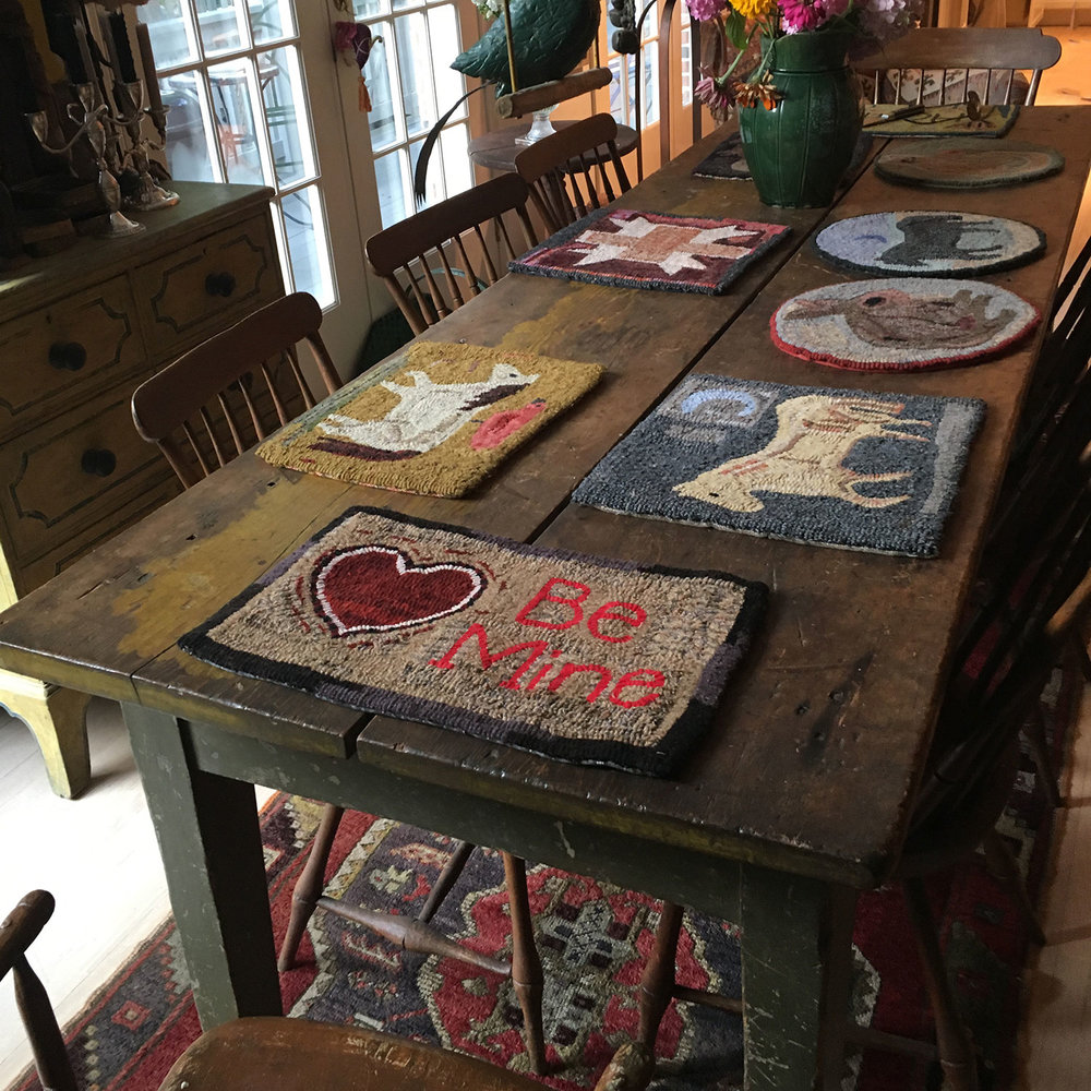 Primitive Hooked Rugs on Farm Table