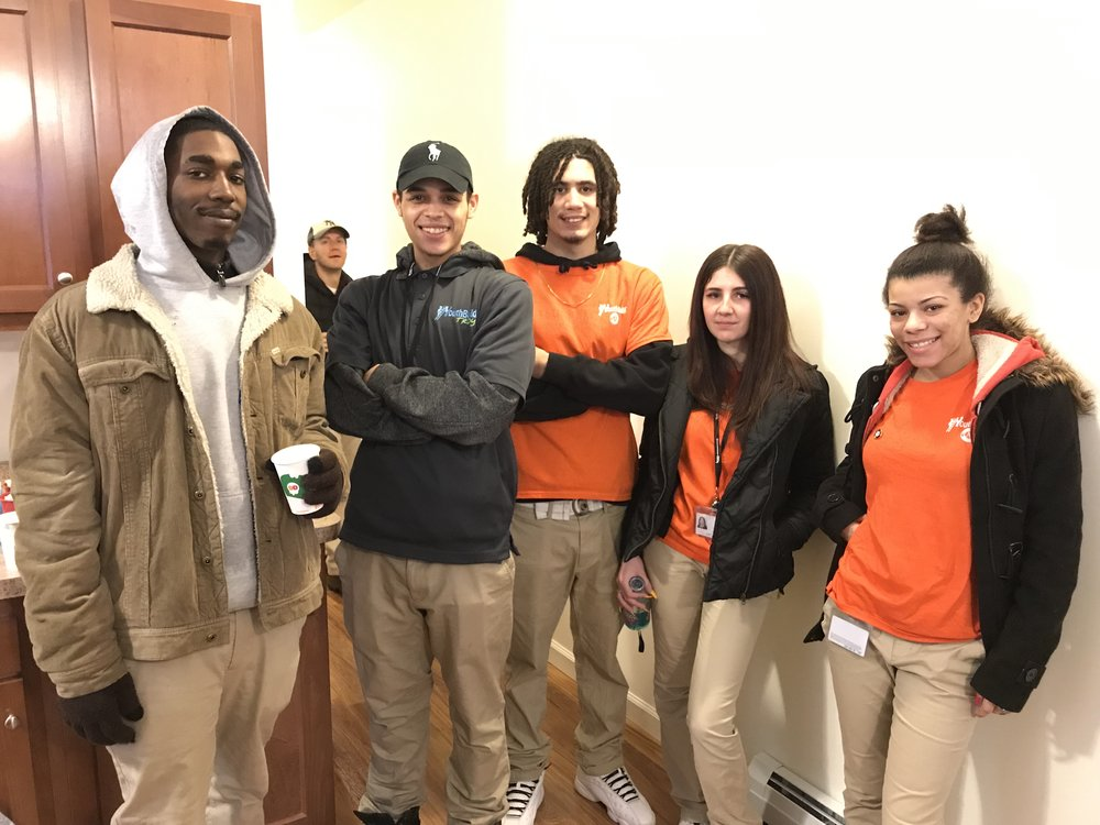 CEO YouthBuild students who worked on the house