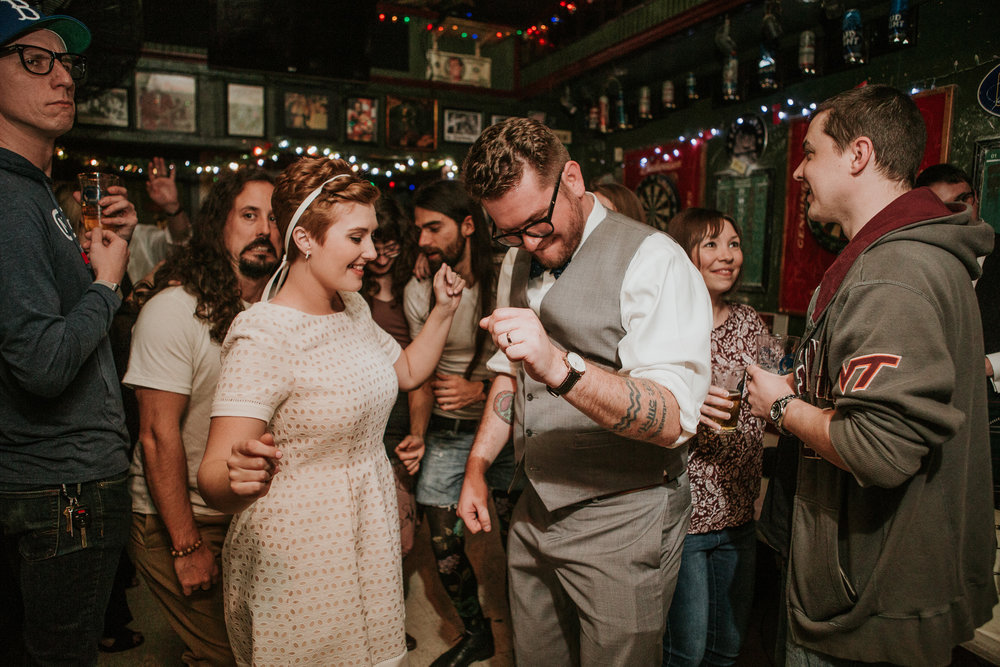 Wedding after-party photography at Egan's Bar in Tuscaloosa, Alabama on March 10th, 2018 by David A. Smith of DSmithImages Wedding Photography, Portraits, and Events in the Birmingham, Alabama area.