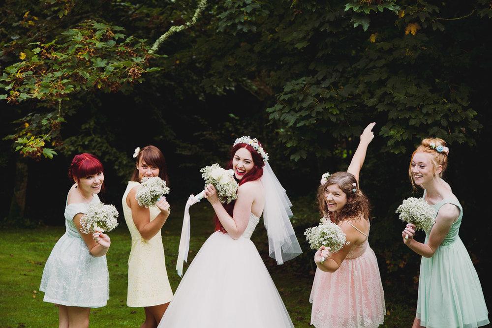 Bride and Bridesmaids having fun - UK Alternative Wedding Photography Chloe Lee Photo