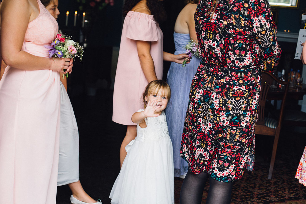 Younger Bridesmaid Waving to Photographer