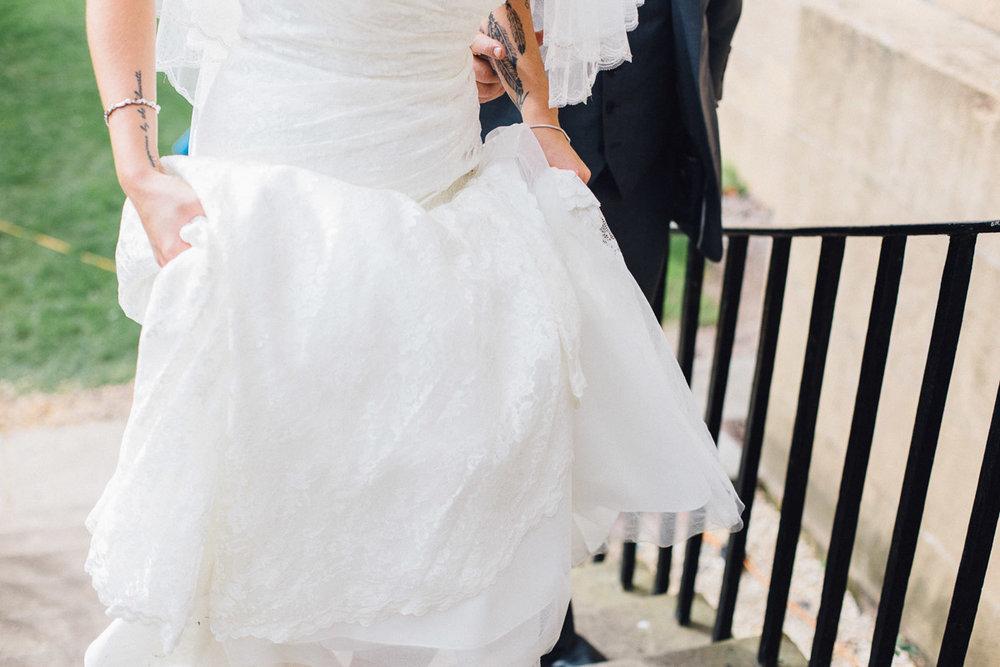 Bride Walking up Steps to Wedding Venue