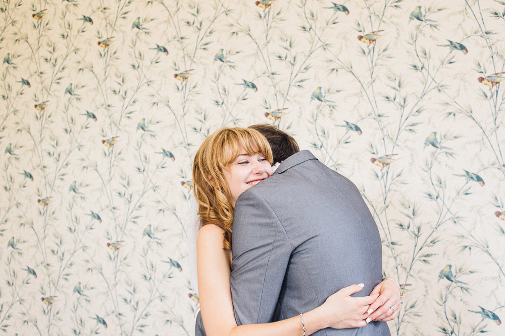 Bride and Groom Hug During Couple Photos