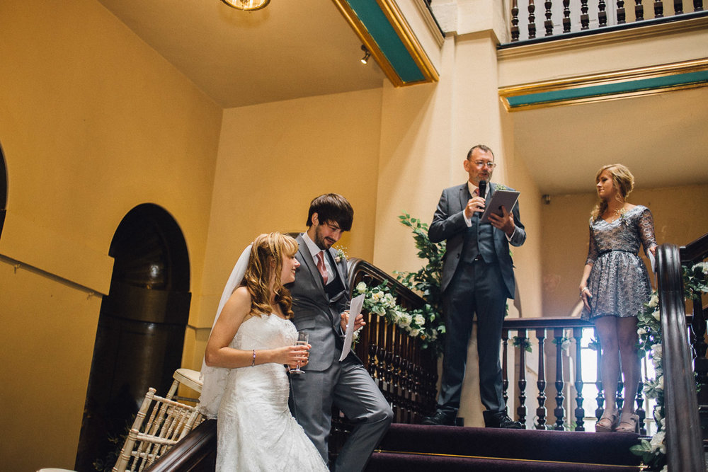 Bride and Groom During Wedding Speeches on Stairs
