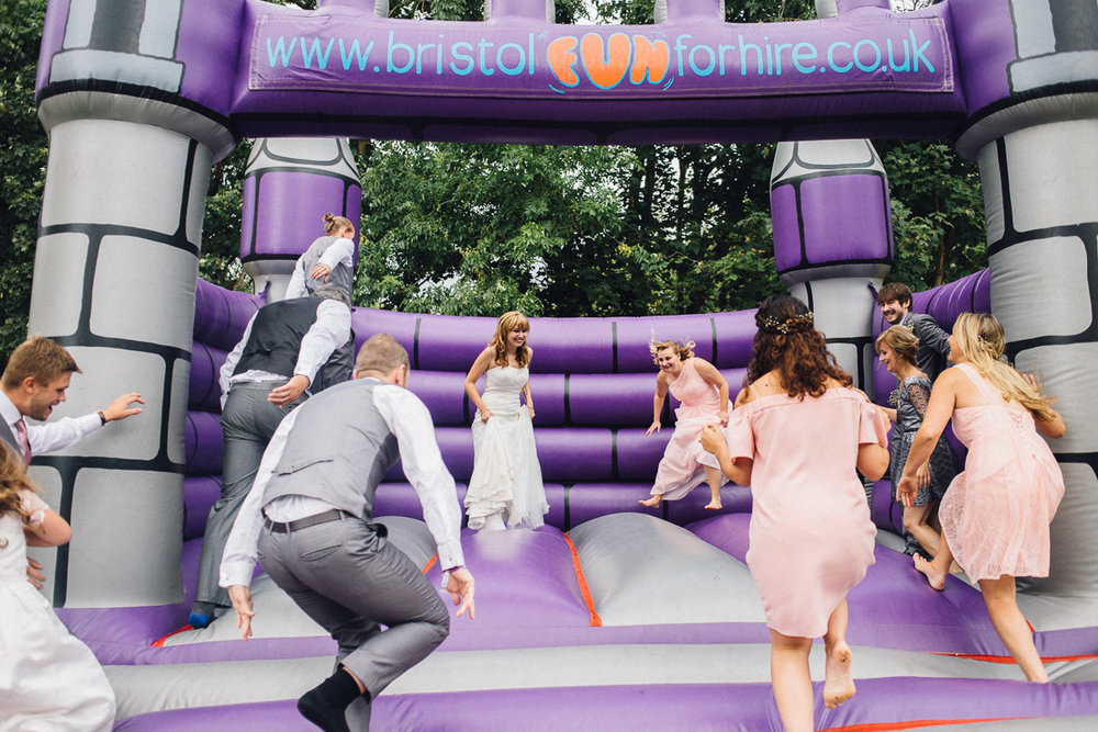 Bridal Party Jump onto Bouncy Castle