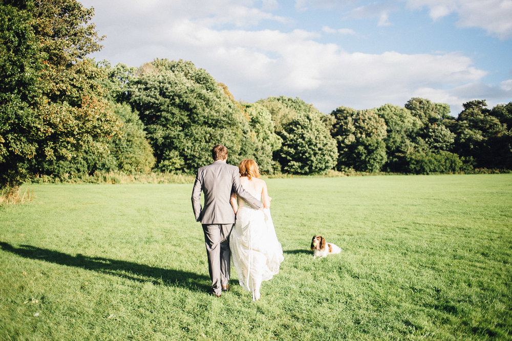 Bride and Groom Walk in Sun for Couple Portraits