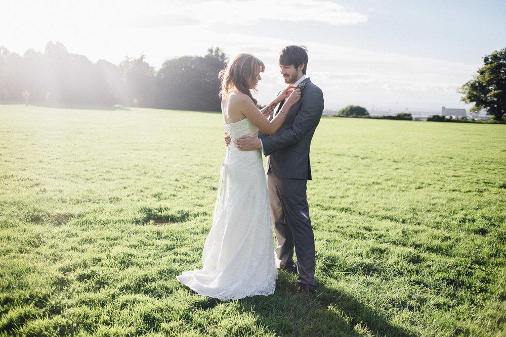 Backlit Sun Couple Portraits in Field