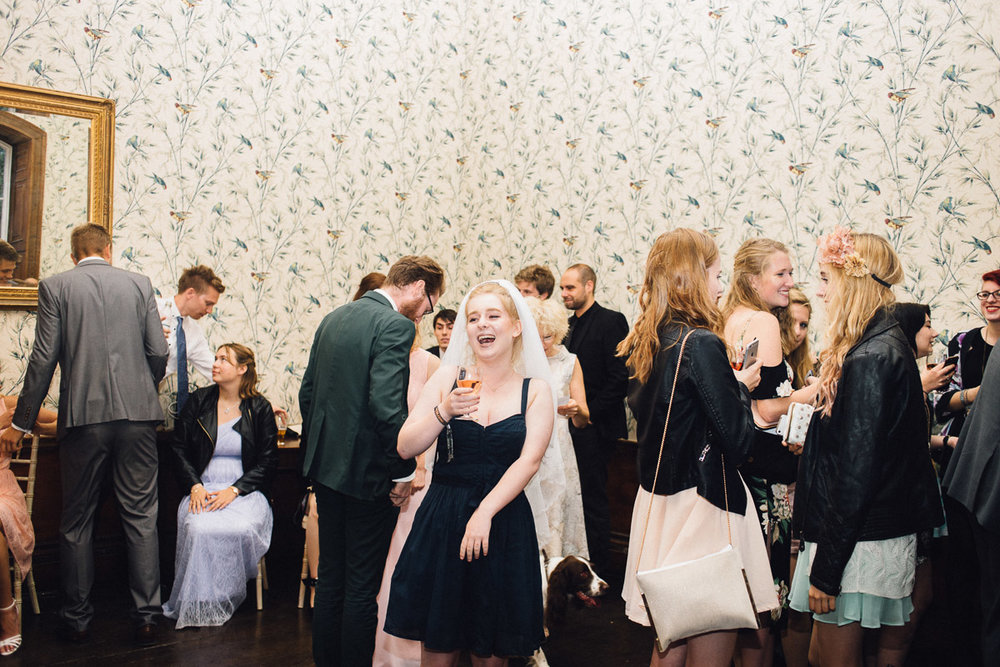 Wedding Guest Wears Brides Veil on Dance Floor