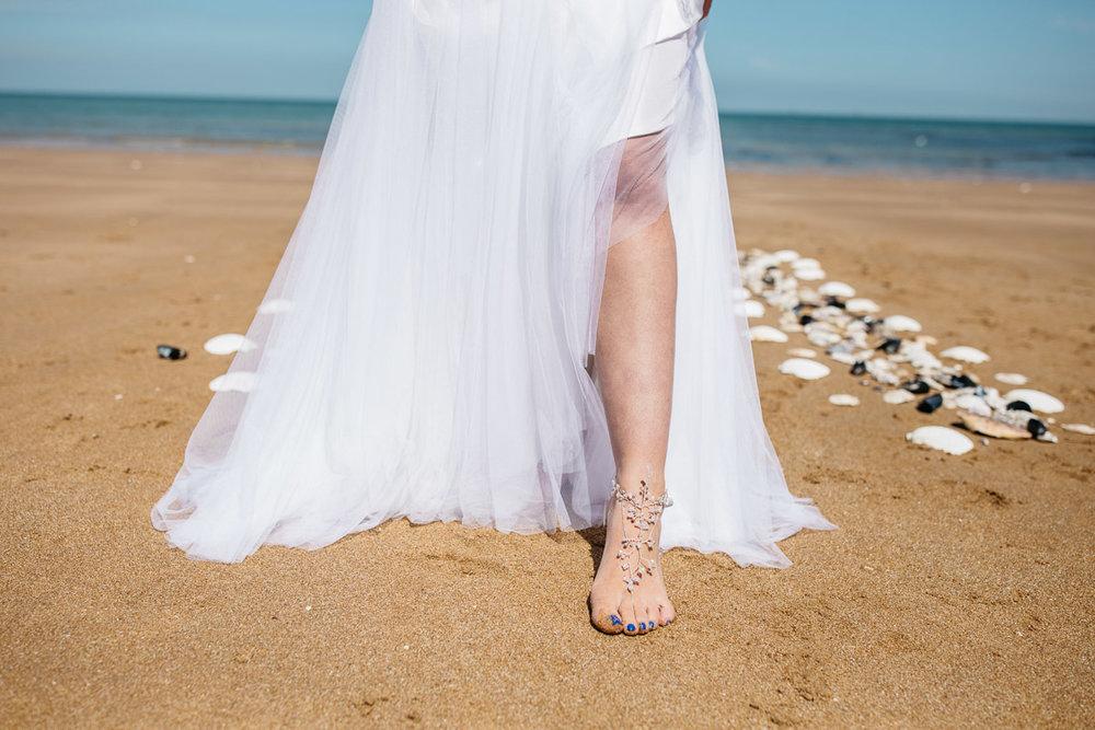 Boho Bride Walking on Beach