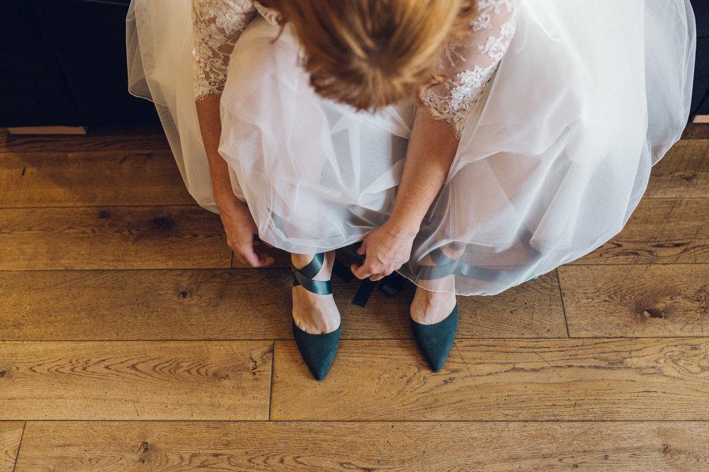 Bride Putting Wedding Shoes On - Lesbian Wedding Channels Estate Essex