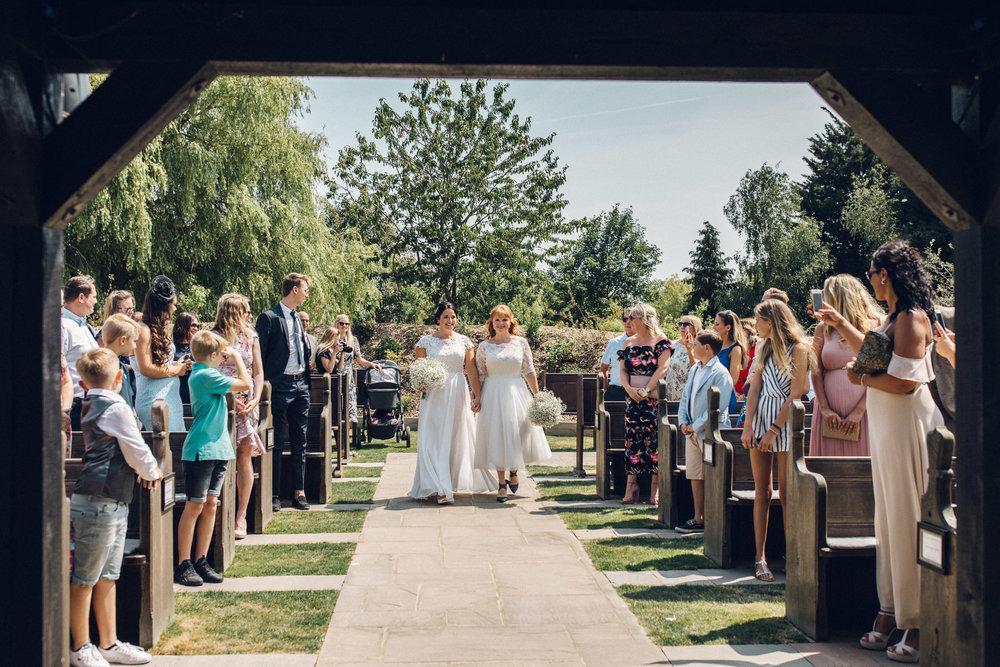 Brides Walking Down Aisle