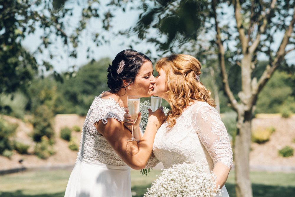 Brides Kiss After Ceremony