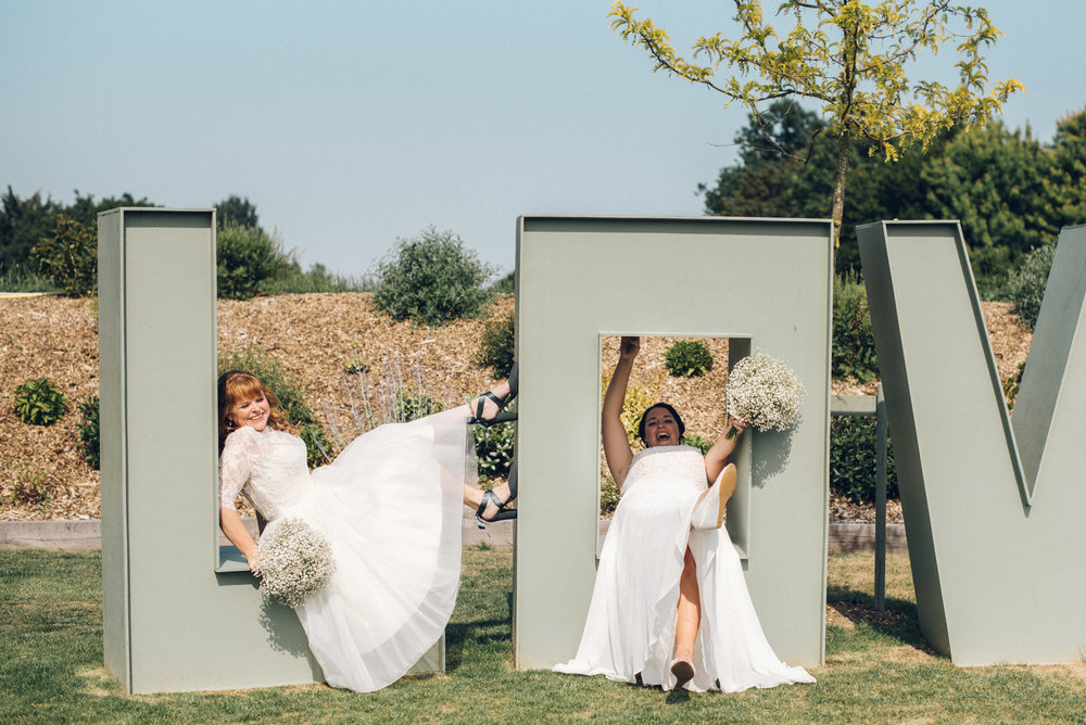Funny photo of Lesbian Brides in Love Sign