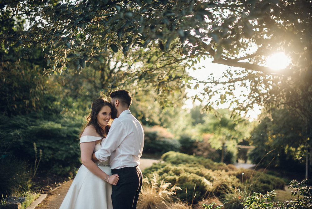 Couple cuddle at Golden Hour, Tudor Barn Eltham