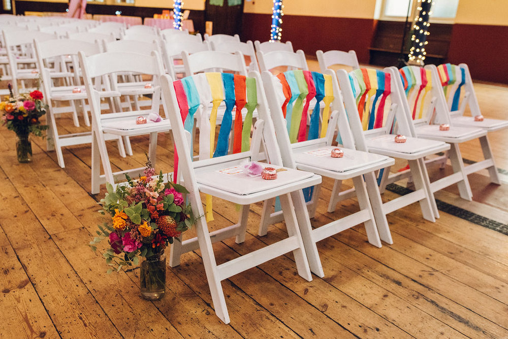 Chairs with coloured paper streamers