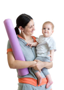 Mother and baby are ready to fitness or yoga exercises isolated