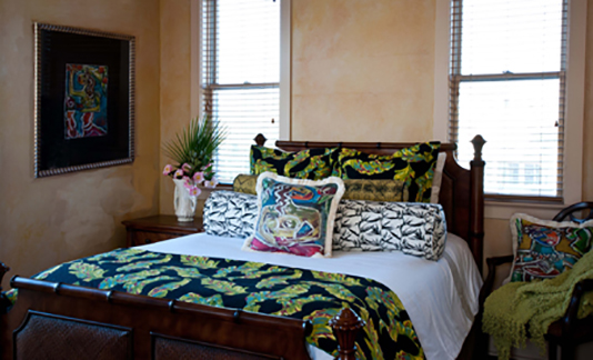 Islandreams Textiles fabrics accentuate the soothing Coastal style of this inviting guest room.