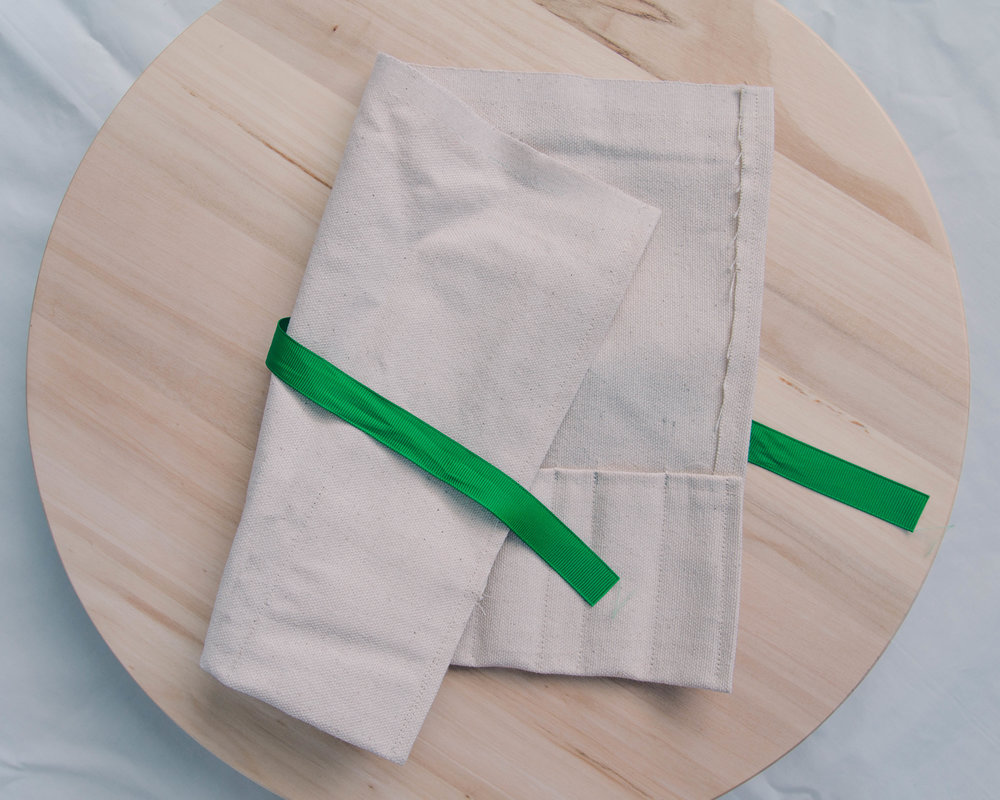 utensil wrap - This utensil wrap is made from 100% cotton that I made myself! Sure it's a little dorky but I don't sweat over it knowing that my planet is a little happier and cleaner.