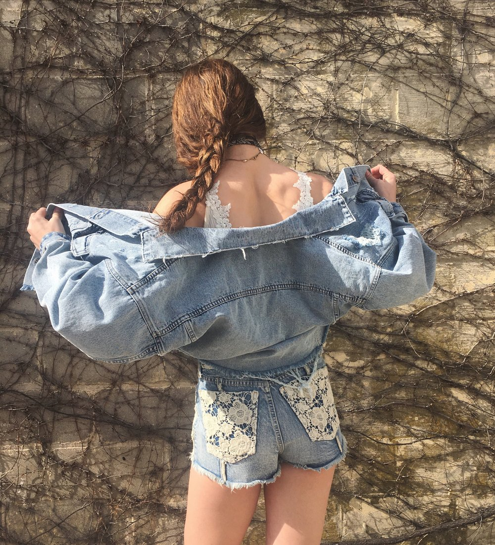 Shorts: $216, Denim Jacket: $238, Bodysuit: $88
