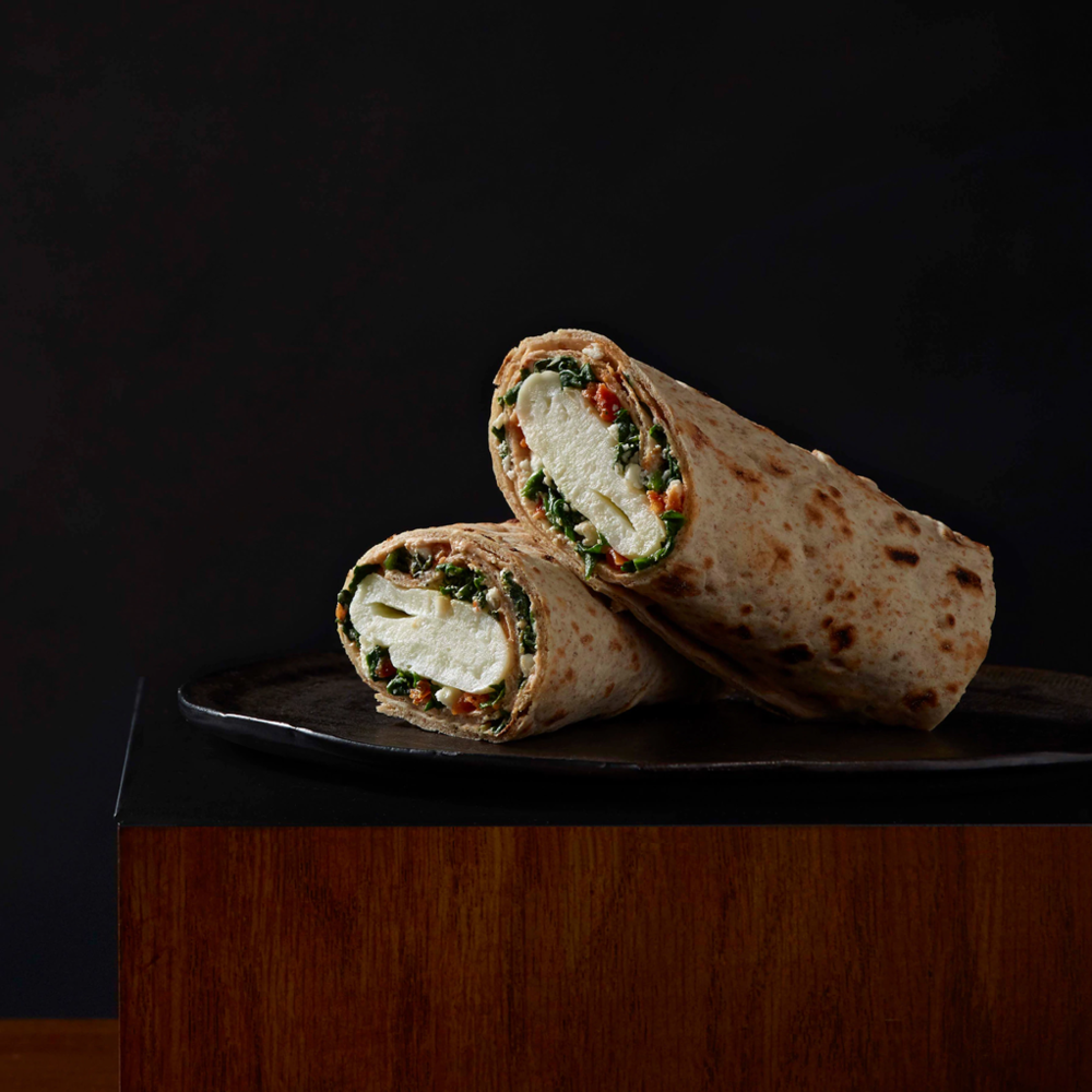 Try this protein-rich, low calorie, whole wheat wrap. The Spinach, Feta & Cage Free Egg White Breakfast Wrap contains 290 Calories, 10g Fat, 6g Fiber, 19g Protein and 830 mg Sodium.   Photo via Starbucks