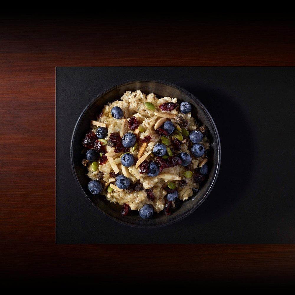 You get whole-grain oats, fresh blueberries and crunchy nuts all in one bowl. The Hearty Blueberry Oatmeal contains 200 calories, 2.5g fat, 5g protein, 5g fiber and 7g sugar.   Photo via Starbucks
