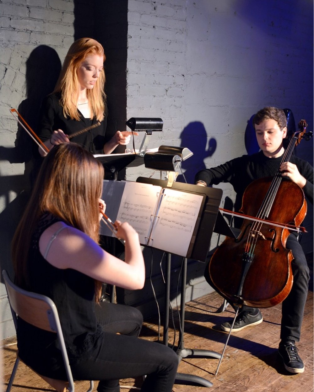 Musicians with composer and conductor, Kelly Catlin