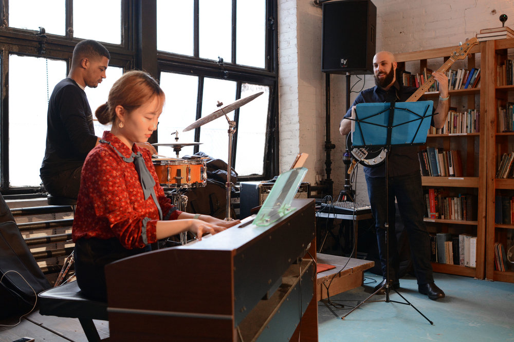 Jazz ensemble, featuring Yeonju Lee on keys, Noah Paul on drums, and GIl Grosman on bass
