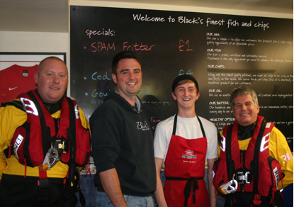 Morecambe Lifeboat crew members James Donnell and Steve Wilson with Matthew Black and Brett Coulton.