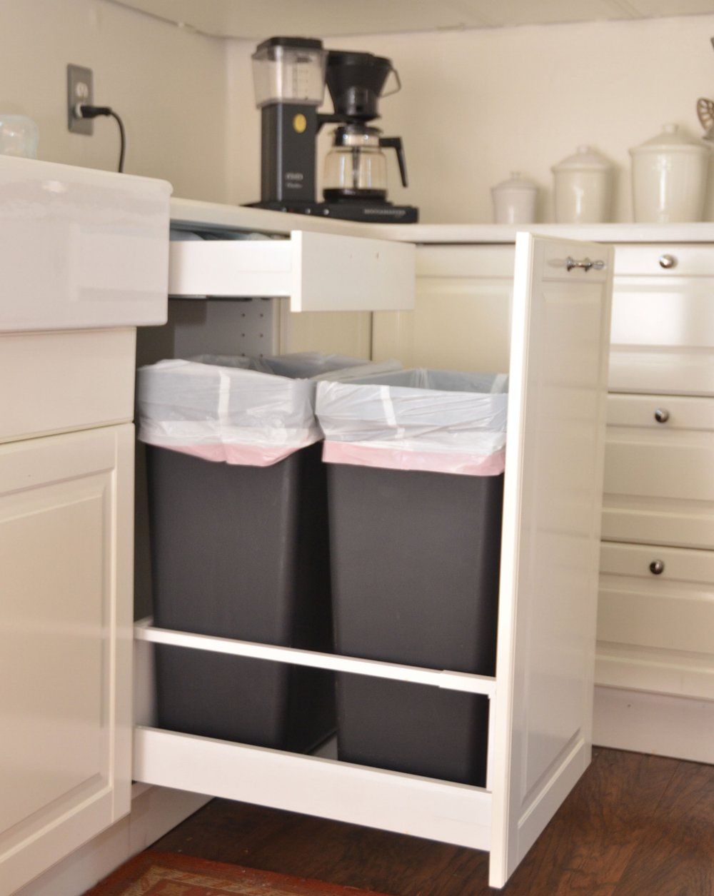 Two Standard Kitchen Sized Trash Cans Fit In This Tall Drawer From Ikea.  Trash