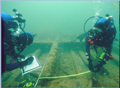 Sea Cadet divers in training measure and document a 19th century shipwreck.