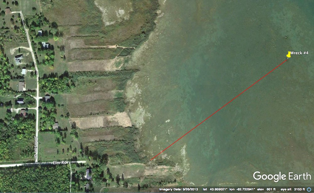 Wreck is 1,300 ft. from shore on a bearing of 55 degrees. A path at the end of Elm Road may provide access. Public parking is not verified. Please respect private property.