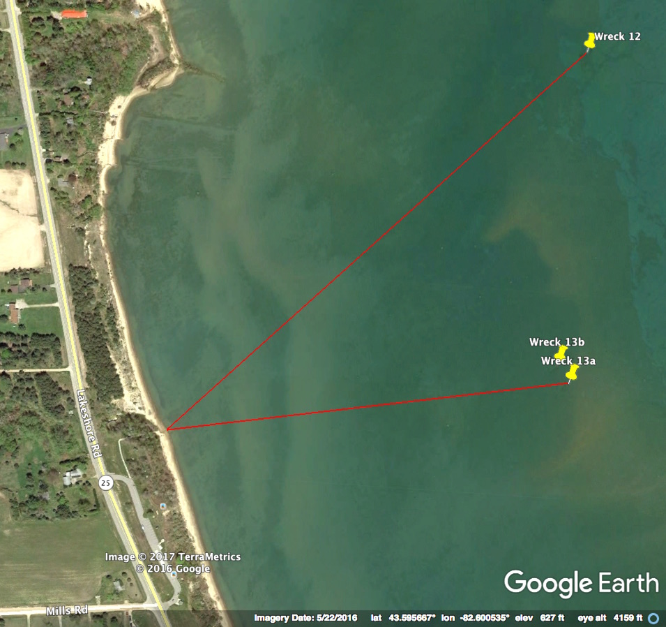 Main wreck (13a) is 1,700 ft. from shore on a bearing of 84 degrees. Other wreckage (13b) is 85 ft. away at 330 degrees Public parking at the Four Mile Scenic Turnout on M-25.