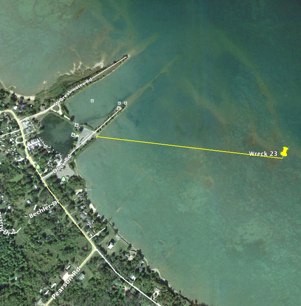 Wreck is 2,335 ft. from shore on a bearing of 97 degrees. Public parking at the DNR access site.