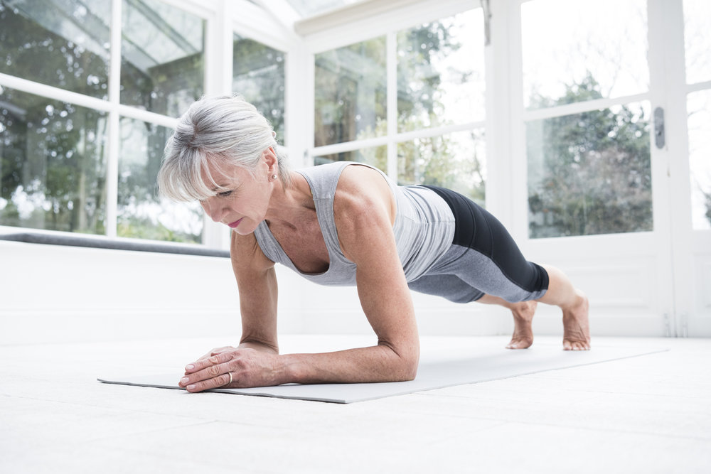 Hold a plank for 1 minute. Try to stay as straight as possible without sticking your rear end too high in the air or sagging your back down. Using your legs and core and pulling your bellybutton in. Piece O' cake!