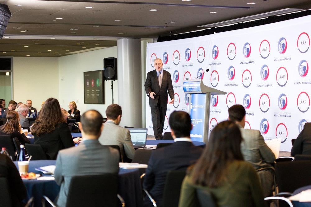 Mark Bertolini speaking (with crowd).jpg