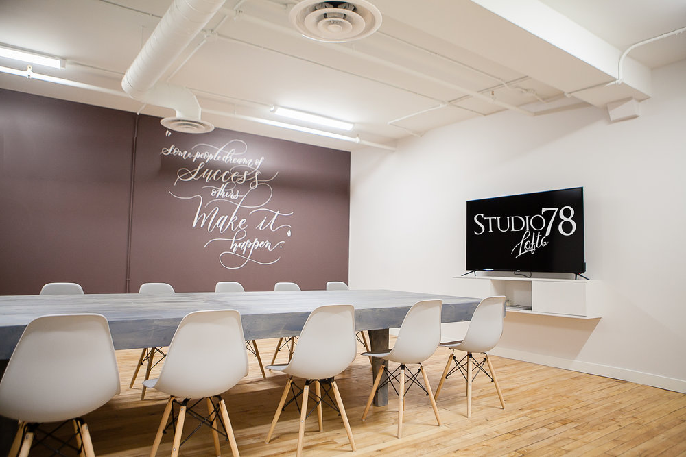 """Large Boardroom - The Layout for the Large Boardroom is 23' deep by 22' wide. Ideal for up to 25 people. Featuring 65"""" TV with Wifi and whiteboards for meetings. Offering coffee and snacks catering services, to appetizers and beverages for evening meetings and workshops."""