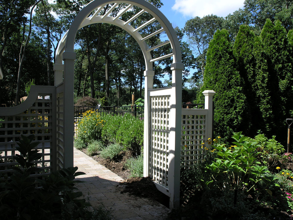 Professional landscape design company with arbor in Long Island, NY