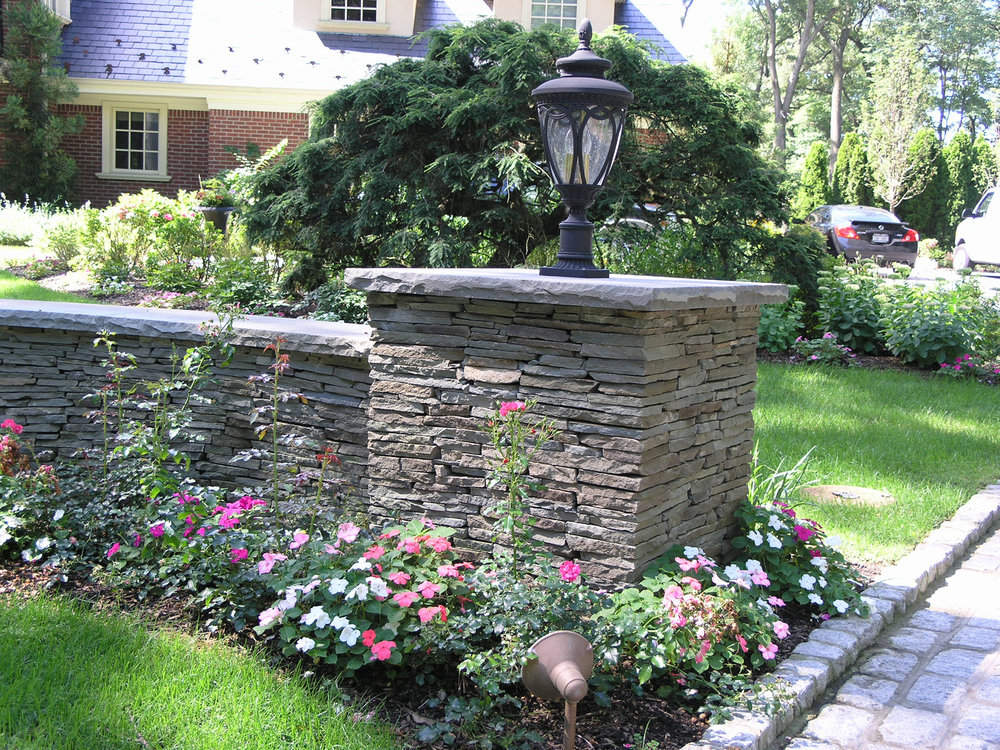 Professional landscape design company with retaining wall in Long Island, NY