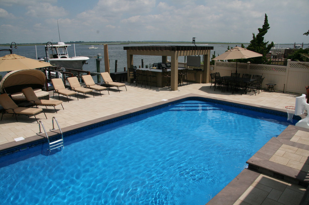 Professional landscape design with a pool pergola in Long Island, NY