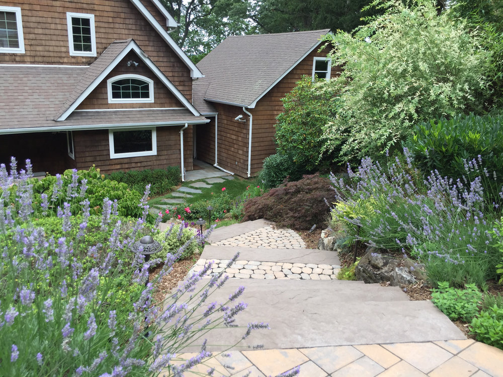 Landscape design with natural stone walkway in Long Island, NY